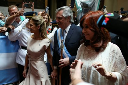 Argentina's President Alberto Fernandez, his partner Fabiola Yanez, and Vice President Cristina Fernandez de Kirchner leave after the inauguration ceremony,in Buenos Aires, Argentina December 10, 2019. REUTERS/Agustin Marcarian