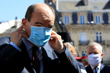French Prime Minister Jean Castex adjusts his protective mask before taking to the media, after the blaze at the Cathedral of Saint Pierre and Saint Paul in Nantes, France July 18, 2020. Laetitia Notarianni/Pool via REUTERS