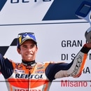 Race winner Repsol Honda Team Spanish rider, Marc Marquez celebrates on the podium following the San Marino MotoGP Grand Prix race at the Misano World Circuit Marco Simoncelli on September 15, 2019. (Photo by Marco Bertorello / AFP)