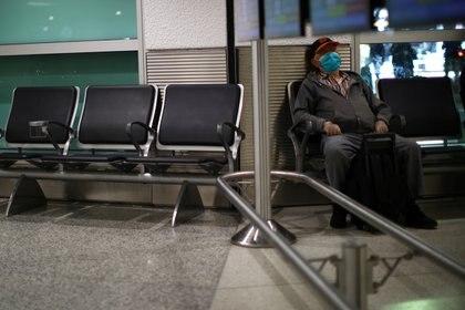 Cruceros atracados en el puerto de Miami, aviones en tierra por la suspensión de vuelos y aeropuertos vacíos: los efectos del coronavirus sobre el turismo(REUTERS/Carlos Barria)