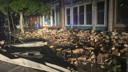 Debris covers the sidewalk in Southport, N.C. as hurricane Isaias moved through North Carolina early Tuesday, Aug. 4, 2020.  (WECT-TV via AP)