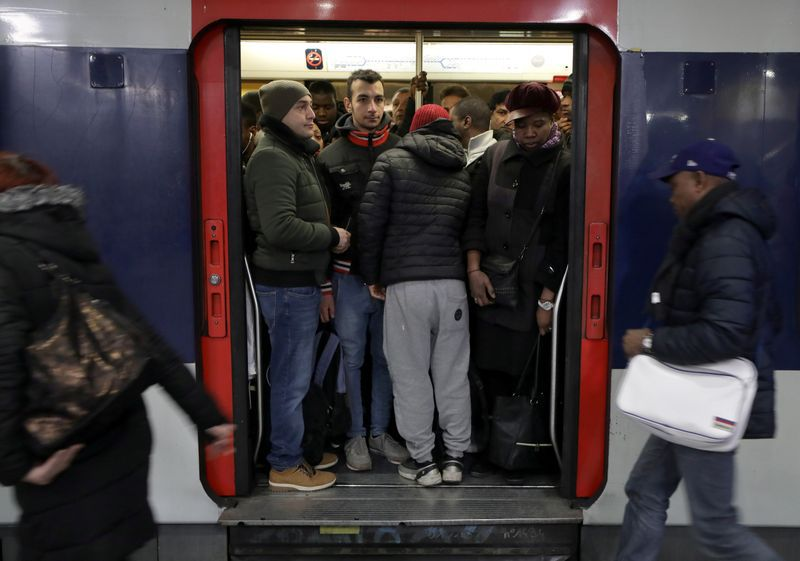 Commuters gather inside a metro at the Gare du Nord RER station during a strike by all unions of the Paris transport network (RATP) and French SNCF workers in Paris as part of a second day of national strike and protests in France, December 10, 2019. REUTERS/Eric Gaillard
