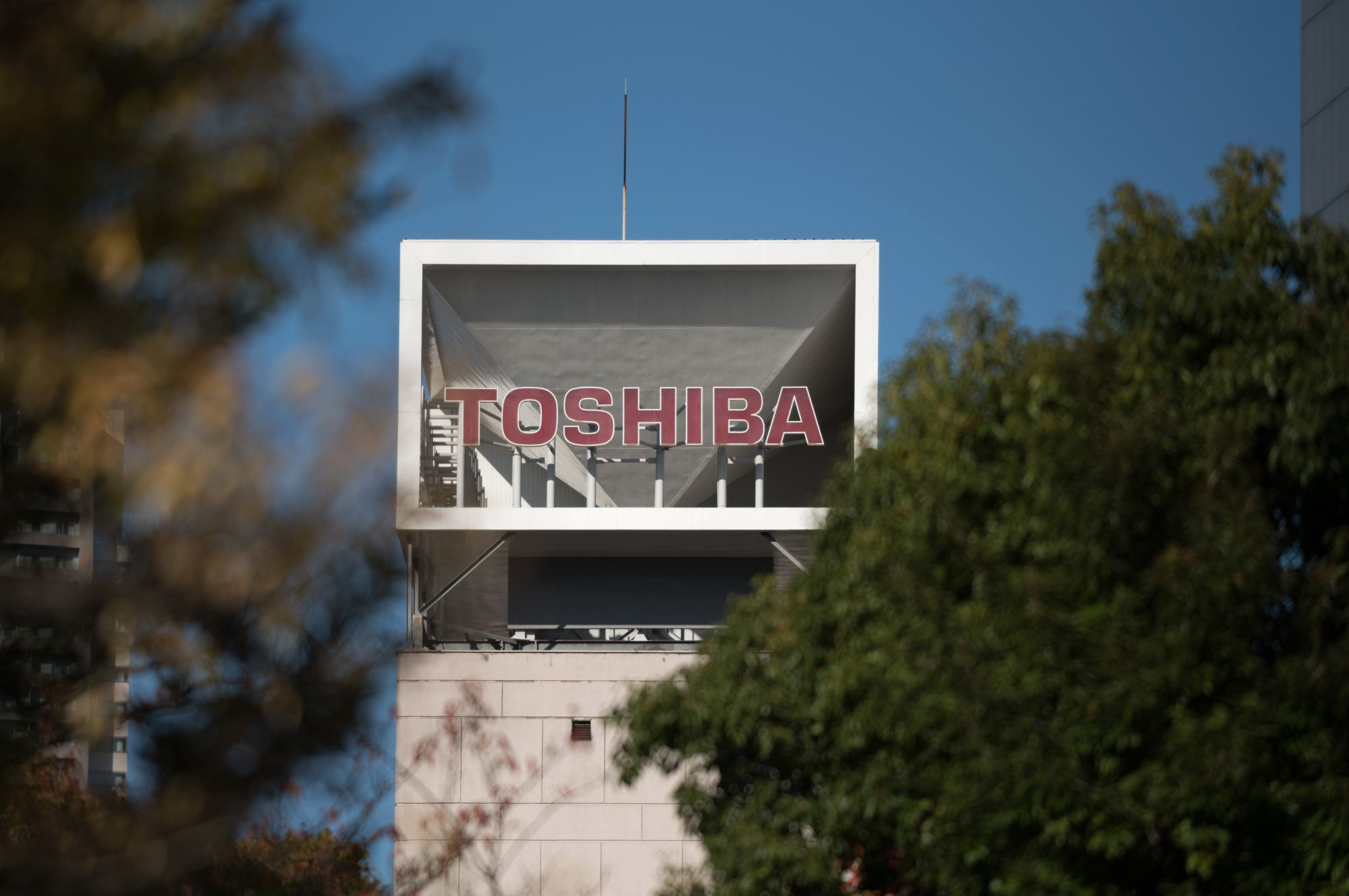 Signage for Toshiba Corp. is seen at the company's headquarters in Tokyo, Japan, on Thursday, Nov. 9, 2017. Toshiba is speeding up investments into a new flash-memory plant even as participation of its joint venture partner Western Digital Corp. remains unclear, ratcheting up the pressure on its U.S. counterpart to resolve a legal spat between two companies. Photographer: Akio Kon/Bloomberg