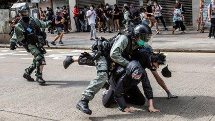 Las fuerzas de seguridad han reprimido las protestas en Hong Kong (Photo by ISAAC LAWRENCE / AFP)