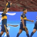Soccer Football - Copa Libertadores - Round of 16 - First Leg - Internacional v Boca Juniors - Beira Rio Stadium, Porto Alegre, Brazil - December 2, 2020 Boca Juniors' Carlos Tevez celebrates scoring their first goal with teammates Pool via REUTERS/Silvio Avila