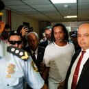Former soccer star Ronaldinho, center, is escorted by police to go before Judge Mirko Valinotti at the Justice Palace court in Asuncion, Paraguay, Friday, March 6, 2020. Ronaldinho has been detained by Paraguayan police for allegedly entering the country with a falsified passport. (AP Photo/Jorge Saenz)