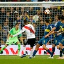 Juan Quintero of Argentina's River Plate, 8, scores his side's second goal against Argentina's Boca Juniors during extra time of the Copa Libertadores final soccer match at the Santiago Bernabeu stadium in Madrid, Spain, Sunday, Dec. 9, 2018. (AP Photo/Andrea Comas)