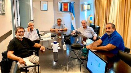 Los dirigentes de la CGT Gerardo Martínez, José Luis Lingeri, Carlos Acuña, Andrés Rodríguez y Héctor Daer