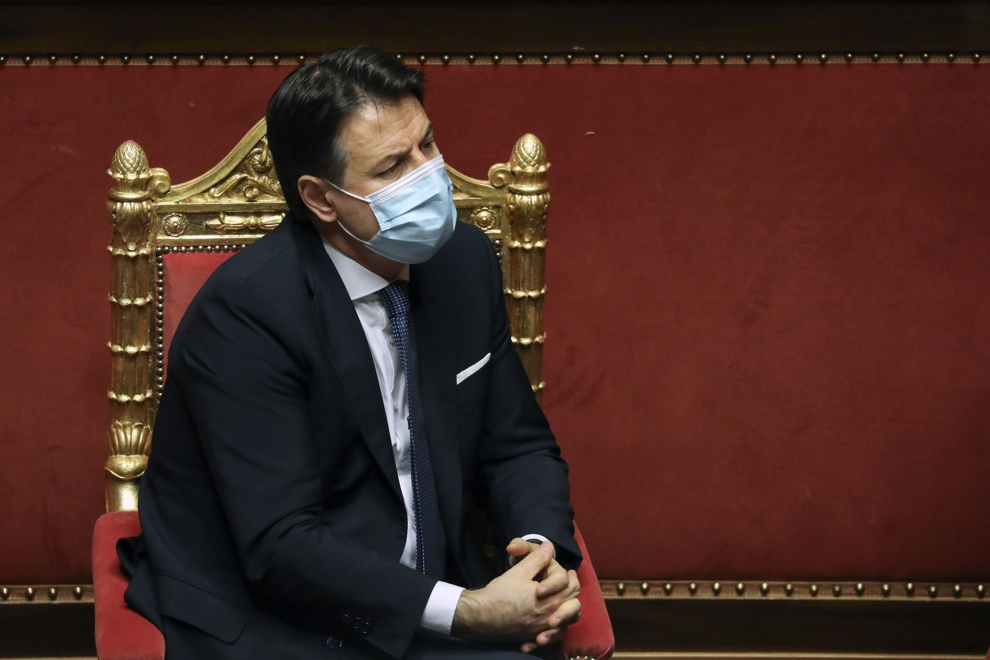 Giuseppe Conte, Italy's prime minister, listens during a debate in the Senate in Rome, Italy, on Tuesday, Jan. 19, 2021. Prime Minister Giuseppe Conte waged a charm offensive Tuesday in the Italian Senate ahead of a vote that will decide whether his coalition can survive.