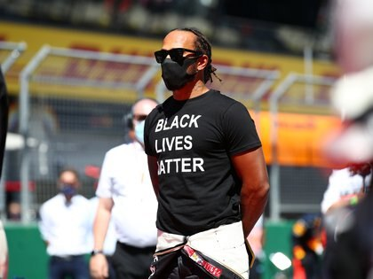 Formula One F1 - Austrian Grand Prix - Red Bull Ring, Spielberg, Styria, Austria - July 5, 2020   Mercedes' Lewis Hamilton wearing an anti-racism T-shirt before the race    Mark Thompson/Pool via REUTERS