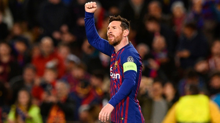 Barcelona's Argentinian forward Lionel Messi celebrates after scoring during the UEFA Champions League round of 16, second leg football match between FC Barcelona and Olympique Lyonnais at the Camp Nou stadium in Barcelona on March 13, 2019. (Photo by Josep LAGO / AFP)