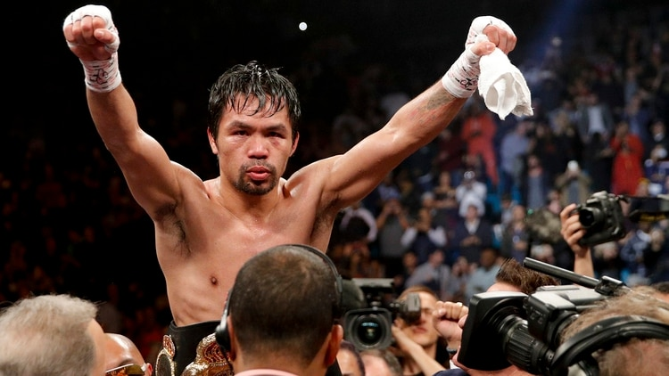 Manny Pacquiao celebra el triunfo ante Adrien Broner