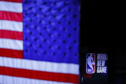 FILE PHOTO: Aug 1, 2020; Lake Buena Vista, USA; The NBA Whole New Game logo is seen before the start of a game between the LA Clippers and the New Orleans Pelicans at HP Field House at ESPN Wide World Of Sports Complex on August 01, 2020 in Lake Buena Vista, Florida. Mandatory Credit: Kevin C. Cox/Pool Photo via USA TODAY Sports