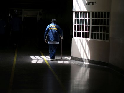 FILE PHOTO: A prisoner walks with the aid of a stick at the California Medical Facility prison in Vacaville, California, U.S., May 23, 2018. REUTERS/Lucy Nichols/File Photo