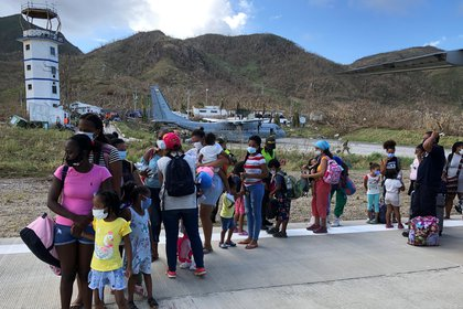 Women and children affected by the passage of Storm Iota line up to board an evacuation flight to San Andres, in Providencia, Colombia November 19, 2020. Picture taken November 19, 2020. REUTERS/Javier Andres Rojas