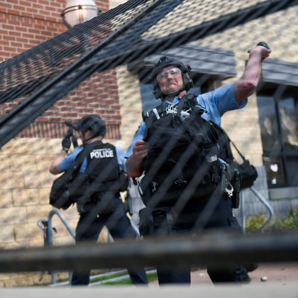 A police officer throws a flash- bang grenade at protesters as they clash with officers outside a Minneapolis police precinct two days after George Floyd died while in police custody, in Minneapolis, Minnesota USA. EFE/EPA/CRAIG LASSIG
