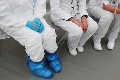 A medical specialist wearing protective gear sitting next to two nurses inside the new immediate response mobile hospital with 50 intensive care beds against the outbreak of coronavirus disease (COVID-19) in Pachuca, Hidalgo, Mexico, March 19, 2020. Picture taken March 18, 2020. REUTERS/Henry Romero