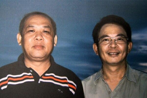 Según Chumlong (der.), él fue un chivo expiatorio de Vixay Keosavang.(The New York Times/Julian Rademeyer)