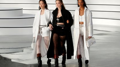 Model Gigi Hadid walks with models on the catwalk to present creations by designer Virginie Viard as part of her Fall/Winter 2020/21 women's ready-to-wear collection show for fashion house Chanel during Paris Fashion Week in Paris, France, March 3, 2020.  REUTERS/Gonzalo Fuentes