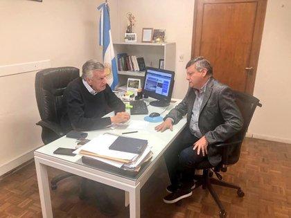 Domingo Peppo con José Luis Gioja en la sede del PJ nacional