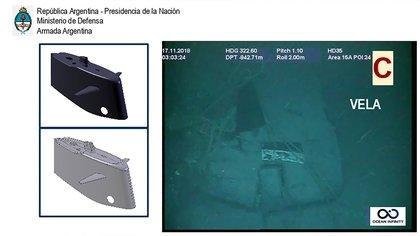 """""""Esta no es muy visible, es la vela, chapa naval, forma hidrodinámica, para protección de los mástiles y la garita de escape, que normalmente está ahí dentro. Esta vela está desprendida del casco resistente, no necesariamente separada, no lo podemos confirmar. La vela está a 90° hacia la banda de babor, es decir hacia la izquierda del submarino"""""""