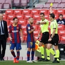 Soccer Football - La Liga Santander - FC Barcelona v Real Madrid - Camp Nou, Barcelona, Spain - October 24, 2020 Barcelona's Jordi Alba is shown a yellow card by referee Juan Martinez Munuera REUTERS/Albert Gea