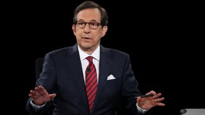 (FILES) In this file photo taken on October 19, 2016 Fox News anchor and moderator Chris Wallace asks the candidates a question during the third U.S. presidential debate at the Thomas & Mack Center in Las Vegas, Nevada. - Chris Wallace, the Fox News anchor who will moderate the first presidential debate between Donald Trump and Joe Biden, is a veteran newsman who has a reputation for playing it straight at a network where the opinion hosts skew to the right. (Photo by JOE RAEDLE / GETTY IMAGES NORTH AMERICA / AFP)