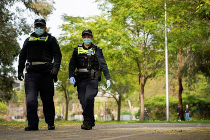 Police officers patrol the grounds outside a public housing tower, reopened the previous night after being locked down in response to an outbreak of the coronavirus disease (COVID-19), in Melbourne, Australia, July 10, 2020. REUTERS/Sandra Sanders