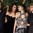US model Cindy Crawford (2nd L), her husband Rande Gerber (L), daughter, US model Kaia Jordan Gerber (2nd R) and son, Presley Gerber (R) pose on the red carpet upon arrival to attend the British Fashion Awards 2018 in London on December 10, 2018. - The Fashion Awards are an annual celebration of creativity and innovation will shine a spotlight on exceptional individuals and influential businesses that have made significant contributions to the global fashion industry over the past twelve months. (Photo by Daniel LEAL-OLIVAS / AFP) / RESTRICTED TO EDITORIAL USE - NO MARKETING NO ADVERTISING CAMPAIGNS