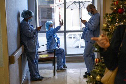 Healthcare workers wait to receive the Pfizer-BioNTech COVID-19 vaccine at the Regional Medical Center in San Jose, California (Bloomberg)