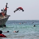 A reveller dives at the Liido Beach during the last Friday ahead of the Muslim holy month of Ramadan, amid the coronavirus disease (COVID-19) pandemic in Mogadishu, Somalia April 9, 2021. REUTERS/Feisal Omar