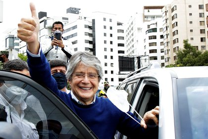 Ecuador's presidential candidate Guillermo Lasso waves to supporters as he leaves the Electoral National Council (CNE) in Quito, Ecuador, February 12, 2021. REUTERS/Cecilia Puebla NO RESALES. NO ARCHIVES