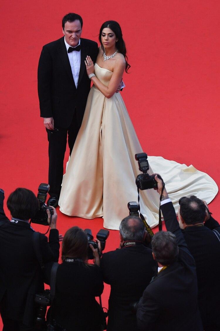Tarantino y Daniella Pick en Cannes , 2019. (Photo by ANTONIN THUILLIER / AFP)