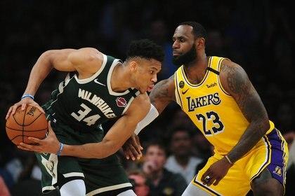 Giannis Antetokounmpo contra LeBron James, un duelo que podríamos ver en las finales de la NBA (Gary A. Vasquez-USA TODAY Sports)