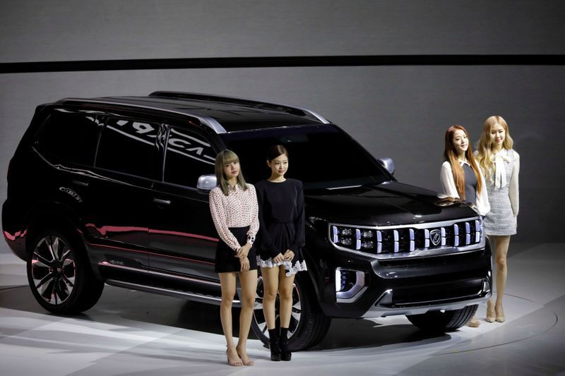 FILE PHOTO: Members of K-pop idol group Black Pink pose for photographs with Kia Motors' Mohave during the 2019 Seoul Motor Show in Goyang, South Korea, March 28, 2019. REUTERS/Kim Hong-Ji/File Photo