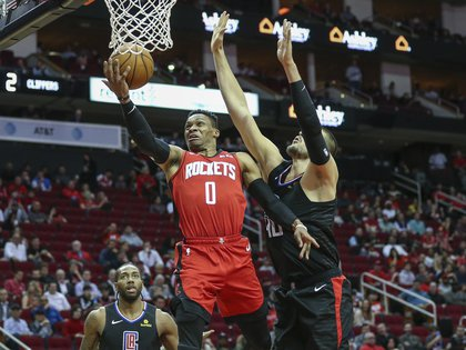 Mar 5, 2020; Houston, Texas, USA; Houston Rockets guard Russell Westbrook (0) shoots the ball as Los Angeles Clippers center Ivica Zubac (40) defends during the first quarter at Toyota Center. Mandatory Credit: Troy Taormina-USA TODAY Sports