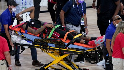 Aug 14, 2020; Lake Buena Vista, Florida, USA; Miami Heat's Derrick Jones Jr is carried off the court on a stretcher after being injured against the Indiana Pacers during the second half of an NBA basketball game at AdventHealth Arena. Mandatory Credit: Ashley Landis/Pool Photo-USA TODAY Sports