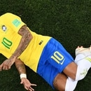 Brazil's forward Neymar reacts after beeing tackled by Switzerland's midfielder Valon Behrami during the Russia 2018 World Cup Group E football match between Brazil and Switzerland at the Rostov Arena in Rostov-On-Don on June 17, 2018. / AFP PHOTO / Jewel SAMAD / RESTRICTED TO EDITORIAL USE - NO MOBILE PUSH ALERTS/DOWNLOADS