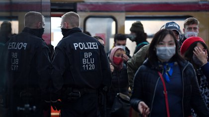 Police officers stroll through the Ostkreuz station and check if people are wearing mouth and nose protection as the spread of the coronavirus disease (COVID-19) continues in Berlin, Germany November 2, 2020.   REUTERS/Annegret Hilse
