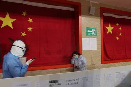 La tardía información sobre la propagación del virus se debe, en gran parte, a que los hospitales chinos también responden a las burocracias del Partido Comunista (China Daily via REUTERS)