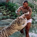 Mandatory Credit: Photo by Markson Sparks/Shutterstock (261215v) MIKE TYSON PLAYING WITH PET TIGER MIKE TYSON PLAYING WITH PET TIGER, LOS ANGELES, AMERICA - 1996