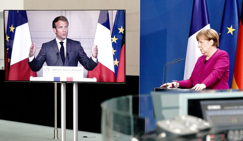 FILE PHOTO: German Chancellor Angela Merkel holds a joint video news conference with French President Emmanuel Macron in Berlin, Germany, May 18, 2020.      Kay Nietfeld/Pool via REUTERS