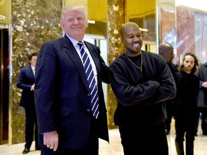 El presidente y el cantante son muy cercanos e inclusive este lo ha recibido en la oficina oval (Foto: AFP/ TIMOTHY A. CLARY)