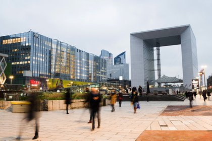 Rush hour morning commuters near the Grande Arche monument in the La Defense business district in Paris, on Jan. 4.