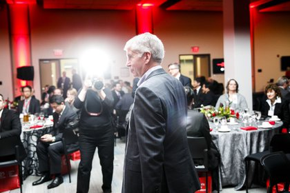 Rick Snyder, governor of Michigan, walks off stage during a grand opening ceremony at the expanded Toyota Motor North American Research & Development (TMNA R&D) center in York Township, Michigan, U.S., on Thursday, May 4, 2017. Toyota is celebrating the 40th anniversary of the company's research and development operations.