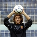 FILE PHOTO: FC Barcelona's Turkish goalkeeper Rustu Recber blocks the ball during his presentation at the Nou Camp stadium in Barcelona, Spain July 1, 2003. REUTERS/Gustau Nacarino/File Photo