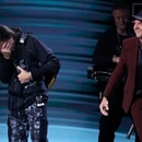 The 20th Annual Latin Grammy Awards - Show - Las Vegas, Nevada, U.S., November 14, 2019 - Juanes reacts as Lars Ulrich of Metallica (R) presents him with the Person of the Year Award. REUTERS/Steve Marcus