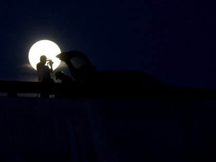 Peaople are seen taking pictures during the full moon in Monterrey, Mexico July 4, 2019. Picture taken July 4, 2020. REUTERS/Daniel Becerril