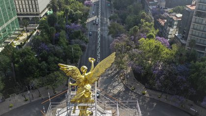 Aerial view of low traffic on Reforma Avenue in Mexico City on March 30, 2020, during the outbreak of the novel coronavirus. (Photo by PEDRO PARDO / AFP)