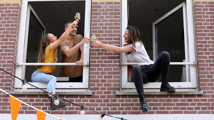 FILE PHOTO: People toast as they party in an apartment to celebrate King's Day (Koningsdag), during the coronavirus disease (COVID-19) outbreak in Amsterdam, Netherlands, April 27, 2020. REUTERS/Eva Plevier/File Photo